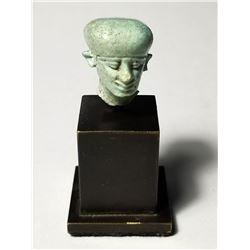 A Faience Egyptian Head of Paitakos Late Dynastic Period. 664-332 BCE.