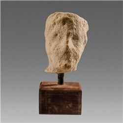 Ancient Cypriot Archaic Limestone head of a man c.7th cent BC.