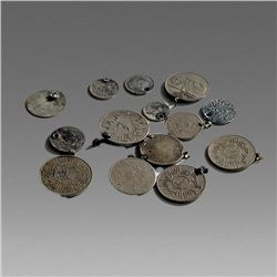 Lot of 14 silver Middle Eastern Silver coins part of necklace.