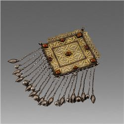 A Turkman Tribal Silver Pendant with stone inset.