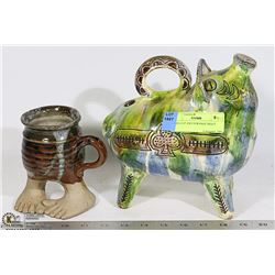 FOOT CUP AND STRANGE PIGGY BEEN REPAIRED