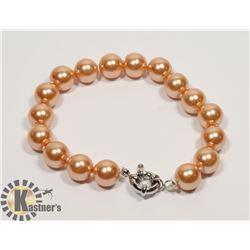 #129-SEA SHELL PEARL BRACELET 10mm/ 8""