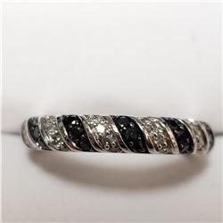 57) 14KT WHITE GOLD BLACK DIAMOND RING. SIZE 7
