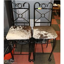 2 GENUINE COWHIDE AND METAL BAR STOOLS
