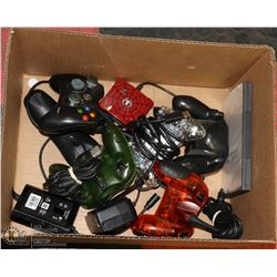 BOX OF ASSORTED GAME CONTROLLERS AND MORE.