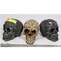 LOT OF 3 DECORATIVE SKULL DECORATIONS.
