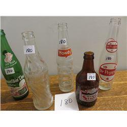 5 bottles - wishing well, mountain dew, howdy, Dr. Pepper etc.