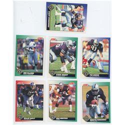 Lot of 7 Oakland Raiders NFL cards. Includes Mervyn Fernandez, Tim Brown, & Max Montoya. All Unc.