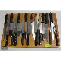 """19 ASSORTED KITCHEN KNIVES AND 24"""" X 16"""" BOARD"""