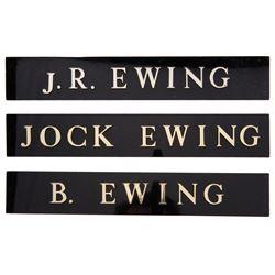 'Bobby Ewing', 'J.R. Ewing', and 'Jock Ewing' nameplates from Dallas.