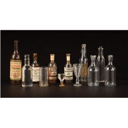 Miniature (12) liquor bottles and glasses from the Golden Safari nightclub in Mighty Joe Young.