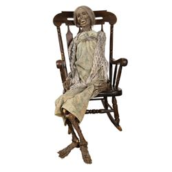 Mummified 'Mother Bates' in a rocking chair from Psycho IV: The Beginning.