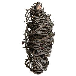 Elizabeth Wilson 'Abigail Craven' figure wrapped in a cocoon of vines from The Addams Family.