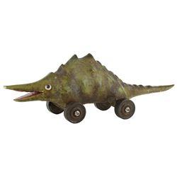 Christina Ricci 'Wednesday Addams' dinosaur toy from Addams Family Values.