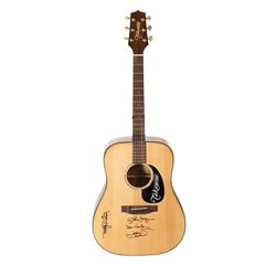 Takamine accoustic guitar signed by The Eagles in case.