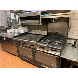Garland Commercial double oven range with griddle and 4 burners. includes salamader -THE BUYER IS RE