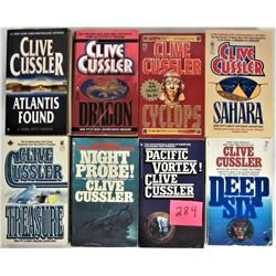 Lot of 8 Soft cover Clive Cussler Adverture pocket books