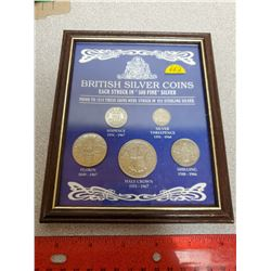 Set of 5 British Silver Coins housed in a wooden frame. Includes 3 pence, 6 pence, shilling, florin