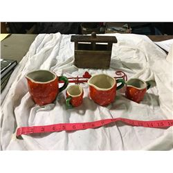 Strawberry measuring cups with metal hanger, and antique butter press
