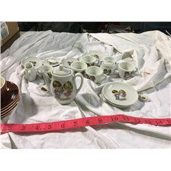 girls miniature tea set (made in japan) 1 bigger and 1 smaller creamers + sugar bowl + 4 bigger cups