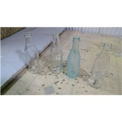 4 CLEAR COKE BOTTLES TALLER ONE BLUISH IS SLIGHTLY CRACKED CHIPPED
