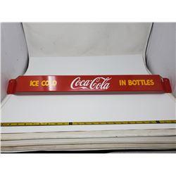 Coke push bar