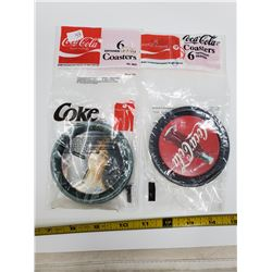 2 packages of 6 each - different design - coca-cola coasters