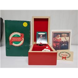 1991 Hallmark Music box playing 'silver bells' with Coca-Cola christmas ornament and fridge magnet.