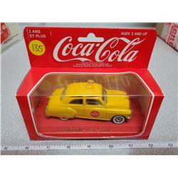 1950 Chevrolet sedan die cast car with coca-cola sign yellow 1990
