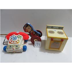 Battery operated child's stove, chatter telephone, gong bell toy