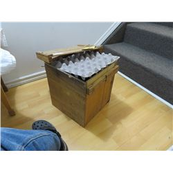 Old wooden egg crate with tag
