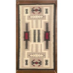 Navajo Storm Pattern Weaving measuring 57 ¾-inches by 34-inches