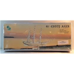 23)  FACTORY SEALED MODELS OF 2 WOODEN