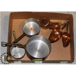 4 COPPER SAUCE PANS AND MEASURING CUPS