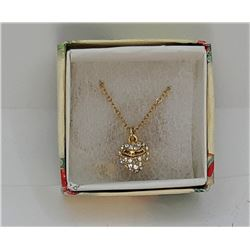 12)  GOLD TONE AND CLEAR CZ HEART