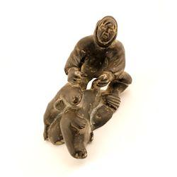 Sculpture Made of Dark Porous Rock  (83543)