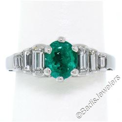 14kt White Gold 1.33 ctw Emerald Solitaire and Baguette Diamond Step Ring