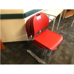 STACK OF RED STACKING STUDENT CHAIRS