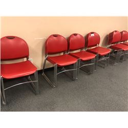 LOT OF RED STACKING STUDENT CHAIRS