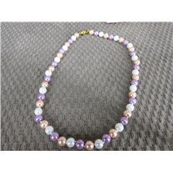 Colored Pearl Necklace Knotted between each Pearl