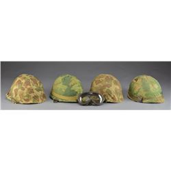 4 US M1 HELMETS W/ CAMOUFLAGE COVERS.