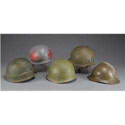 4 WWII US HELMETS & 1 WWI FRENCH AIR CORPS HELMET.