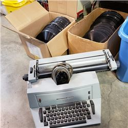 UNDERWOOD ELECTRIC TYPEWRITER AND 2 BOXES OF RECORDS