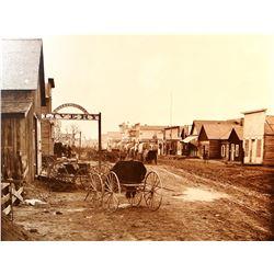 "Huffman, L. A. framed photo print, Main Street Miles City, 16"" h x 24"" w"