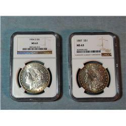 2 Morgan dollars, 1887 and 1904-O, both NGC 63