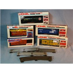Lionel O gauge: 3 cabooses, tank car and box car, all NIB, and assorted used O gauge track