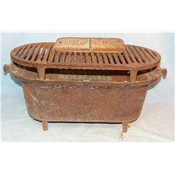 Atlanta Stove Co. Sportsman cast iron oval stove w/original grate. Atlanta, GA.