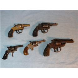 Group of 6 older hand guns: S & W .38, sn: 543257; US Revolver .32, sn: 47441; Young America DA .22,