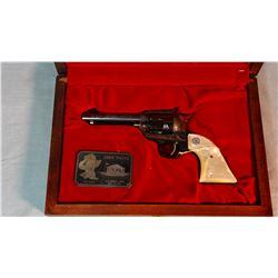 """Colt New Frontier 22, John Wayne the Duke Commem., pearl grips, 4 1/2"""" bbl, .22 cal. In wooden case,"""