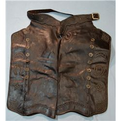 Fancy studded batwing chaps, cut-out star conchos, studded moons, stars, horseshoes and diamonds. Be